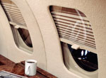 Mechanical window shades for a Falcon 20 interior